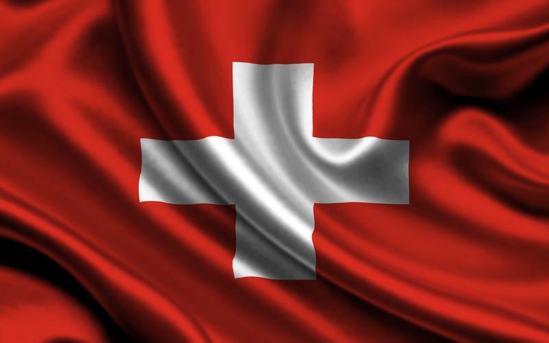que significa el color rojo de la bandera de suiza